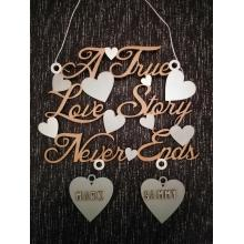'A True Love Story Never Ends'  quote with personalised hanging hearts