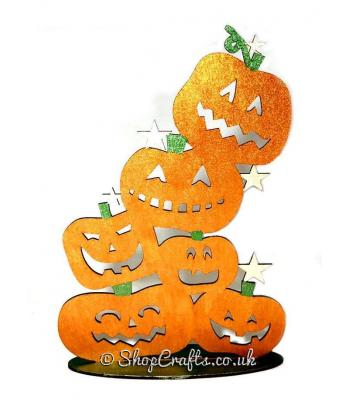 Tumbling pumpkins on stand Halloween decoration.