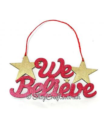 """We Believe"" Christmas hanging sign with stars."