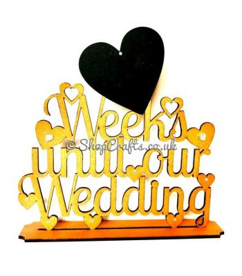"""Week until our wedding"" countdown sign on stand"