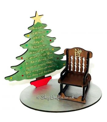 """Christmas in Heaven"" memorial Christmas tree and rocking chair on stand."