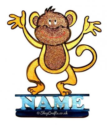 Cheeky monkey shape on stand with name.