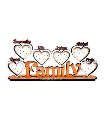 Family name with personalised heart photo frames on stand.