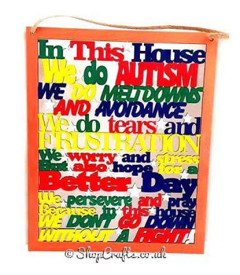 'In this house... we do Autism' hanging sign