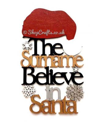 Personalised ' The Surname Believe in Santa' quote hanging sign with Santa Hat on top
